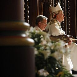 Deacon Drew Peterson, left, and The Most Reverend John C. Wester take part in Easter Mass at the Cathedral of the Madeleine Sunday, April 8, 2012 in Salt Lake City.