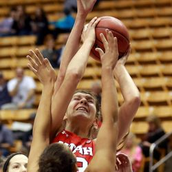 Utah's Emily Potter tries to shoot over BYU's Morgan Bailey during a women's basketball game at the Marriott Center in Provo on Saturday, Dec. 14, 2013. Utah won in double overtime 82-74.