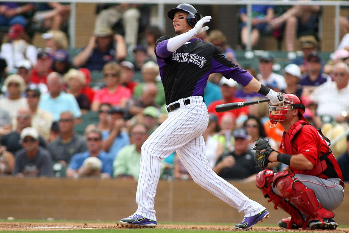 Mar 25, 2012; Salt River Pima-Maricopa, AZ, USA; Colorado Rockies shortstop Troy Tulowitzki (2) flys out during the second inning against the Cincinnati Reds at Salt River Fields at Talking Stick.  Mandatory Credit: Jake Roth-US PRESSWIRE