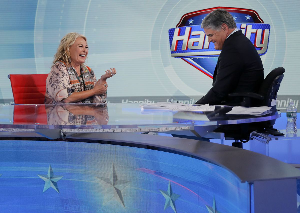 Roseanne Barr talks with Fox News talk show host Sean Hannity while being interviewed during a taping of his show, Thursday, July 26, 2018, in New York.   Julie Jacobson