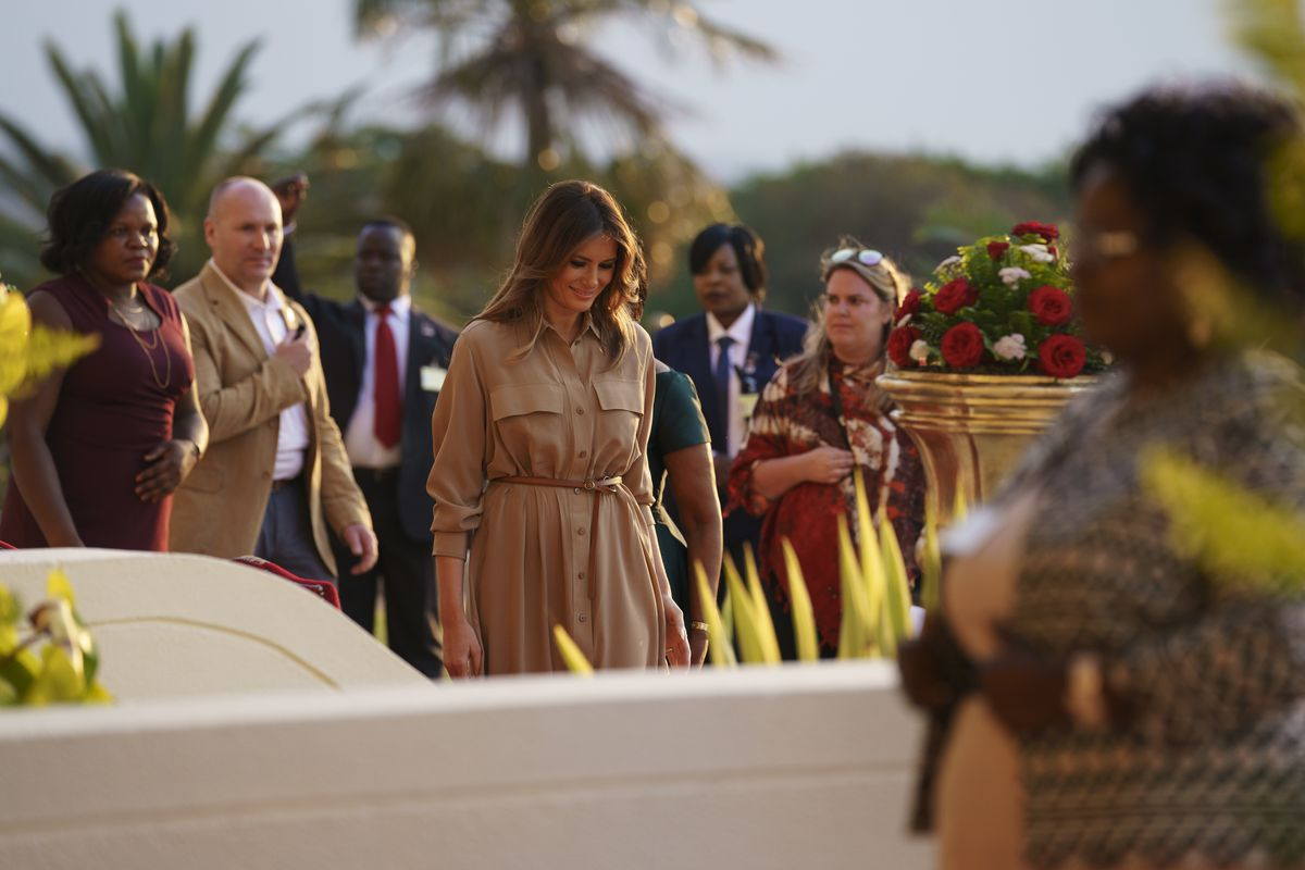 First lady Melania Trump walks from a dance presentation at the State House, in Lilongwe, Malawi, Thursday, Oct. 4, 2018. Mrs. Trump is visiting Africa on her first big solo international trip, aiming to make child well-being the focus of a five-day, four