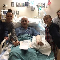 Jarem Hallows, who was recently diagnosed with cancer,  and his family visit in the hospital, post-surgery.