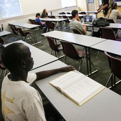 James Majok looks through his textbook as Daniel Poole teaches a sociology course at the Salt Lake Community College South City Campus in Salt Lake City on Thursday, Sept. 14, 2017.