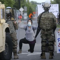 A woman who declined to give her name yells at members of the Utah National Guard after a rally in downtown Salt Lake City on Monday, June 1, 2020. Recent protests against police brutality, racial discrimination and the killing of George Floyd turned violent in Salt Lake City and other cities across the nation, prompting Gov. Gary Herbert to call in the Utah National Guard.
