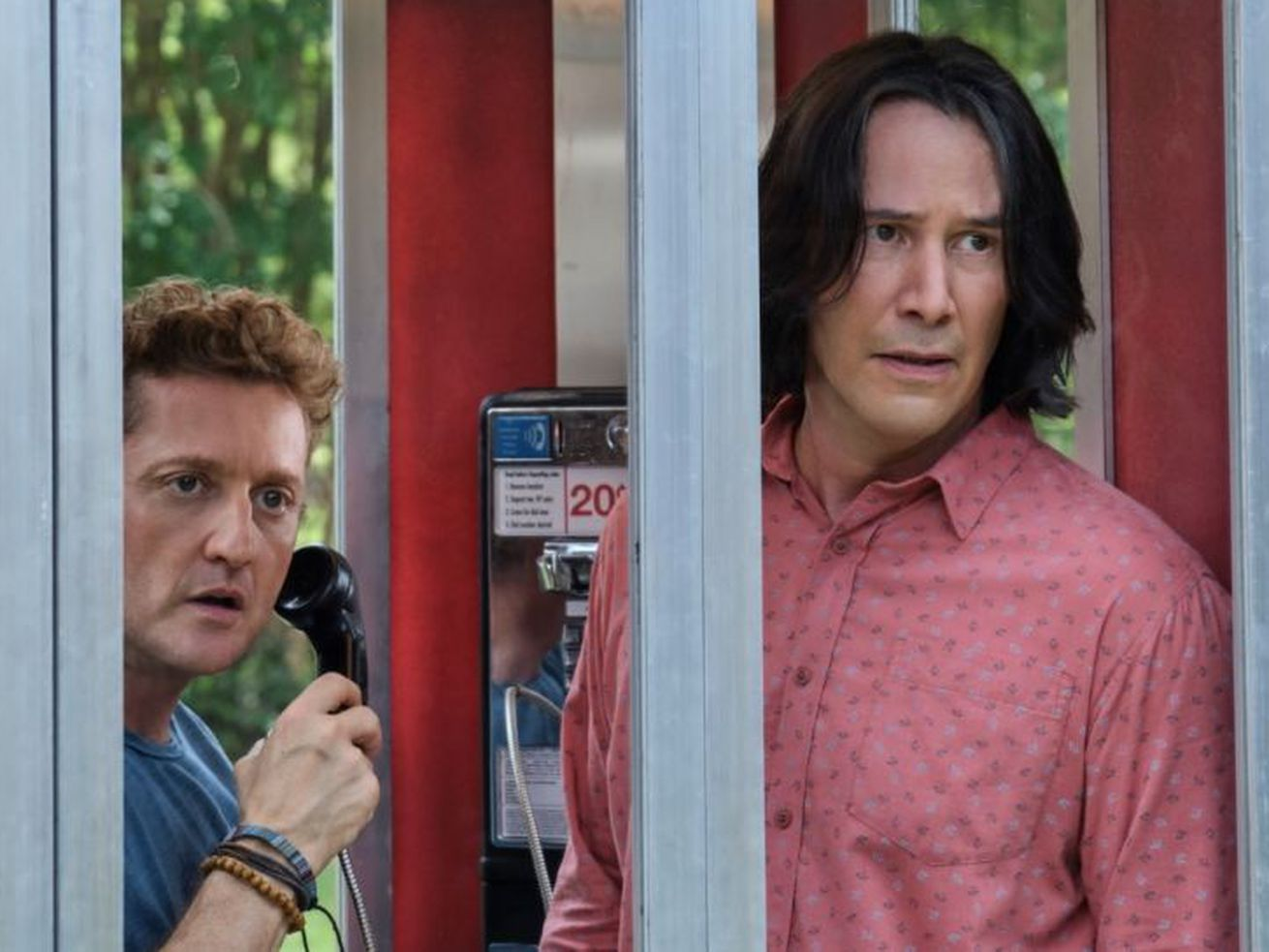 Alex Winter and Keanu Reeves in Bill and Ted Face the Music, standing in a phone booth.