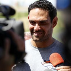 Broncos QB Mark Sanchez spends time talking with the media after their workout on the last day of training camp.