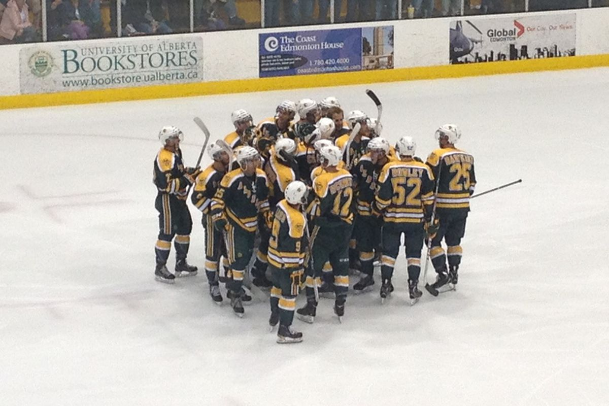 The U of A Golden Bears celebrate a win over the Oilers Rookies