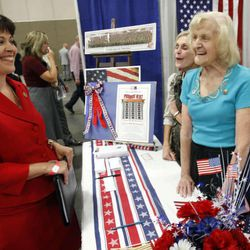 Becky Lockhart talks with Corraine Turner (right) and Susan Baker (center back) of the Republican club during the 2011 Republican State Convention Saturday, June 18, 2011 at South Towne Exposition Center.