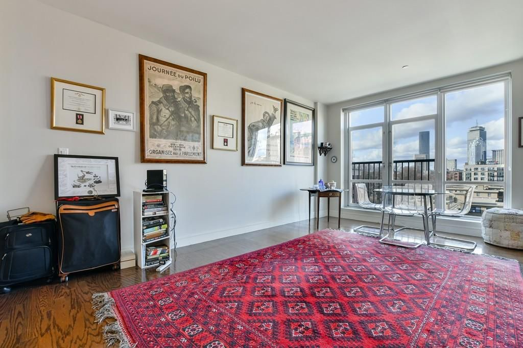 A sizable, largely empty living room leading to a small terrace.