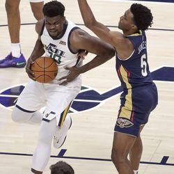 Utah Jazz center Udoka Azubuike (20) tries to shoot around New Orleans Pelicans forward Herbert Jones (5) during a preseason NBA game at the Vivint Smart Home Arena in Salt Lake City on Monday, Oct. 11, 2021. The Jazz won 127-96.