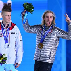 Sage Kotsenburg (USA), right, and Staale Sandbech (NOR) react after receiving their medals during the medal ceremony for the snowboard slopestyle