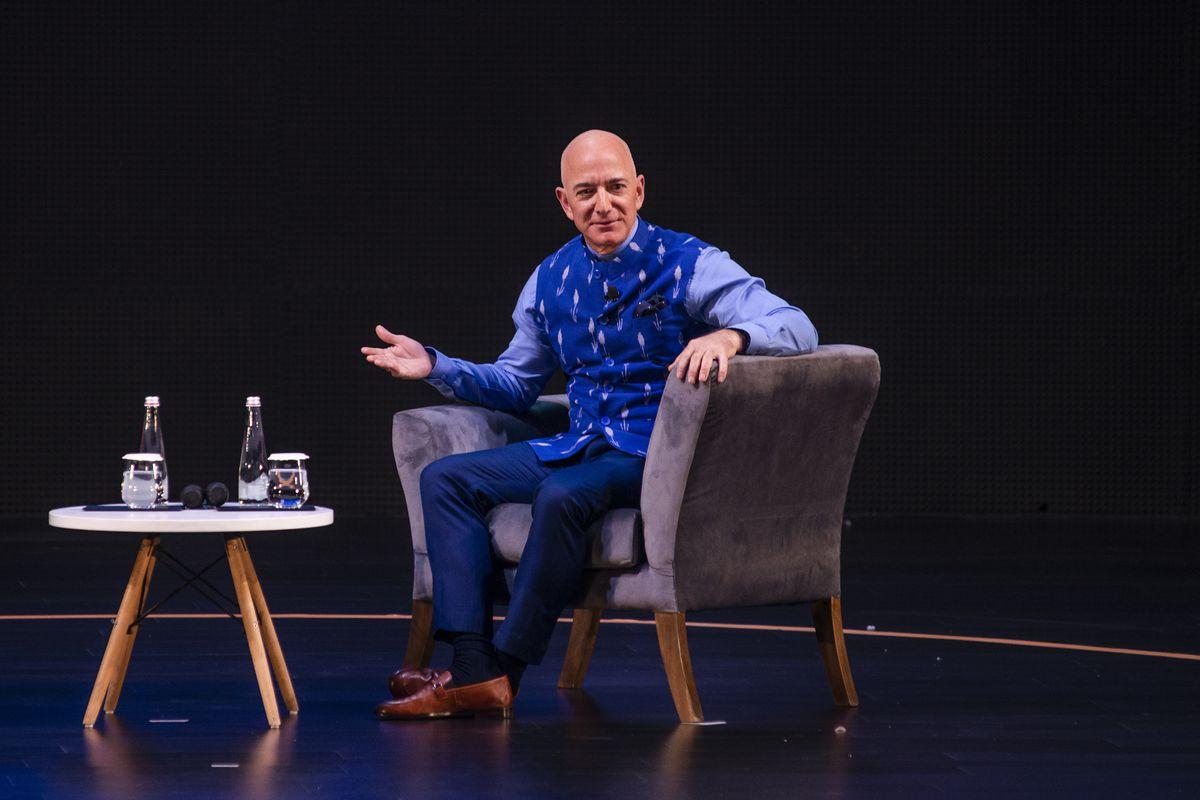 Amazon CEO Jeff Bezos seated onstage.