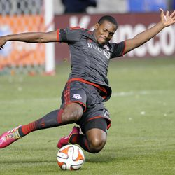 Toronto FC defender Doneil Henry (15) slides for the ball during a game against Real Salt Lake at Rio Tinto Stadium in Sandy on Saturday, March 29, 2014.