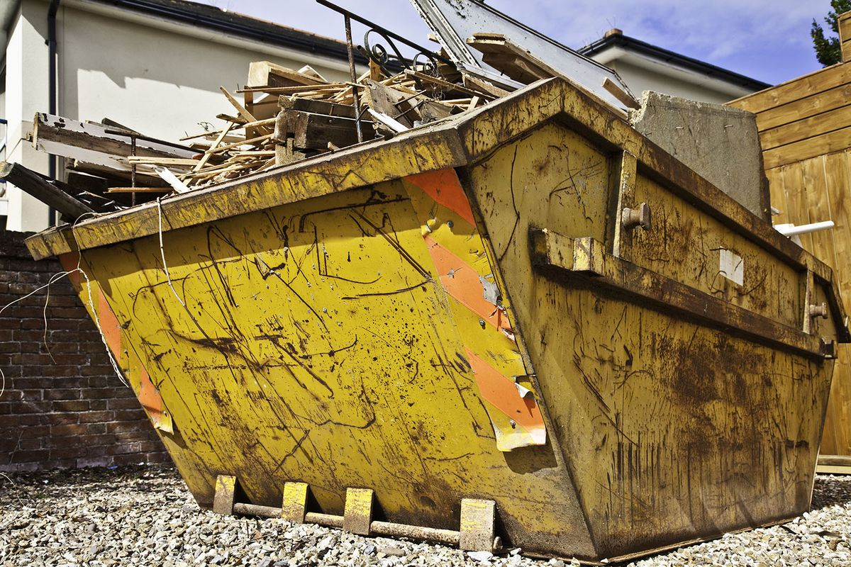 A dumpster at a construction site.
