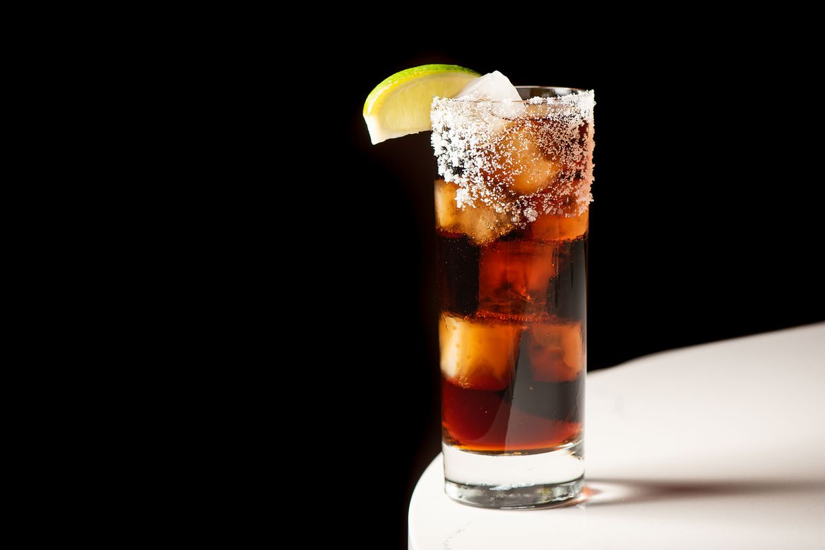 Batanga: tequila or mezcal with Mexi Coke and a salted rim stirred with a steak knife at Lanea