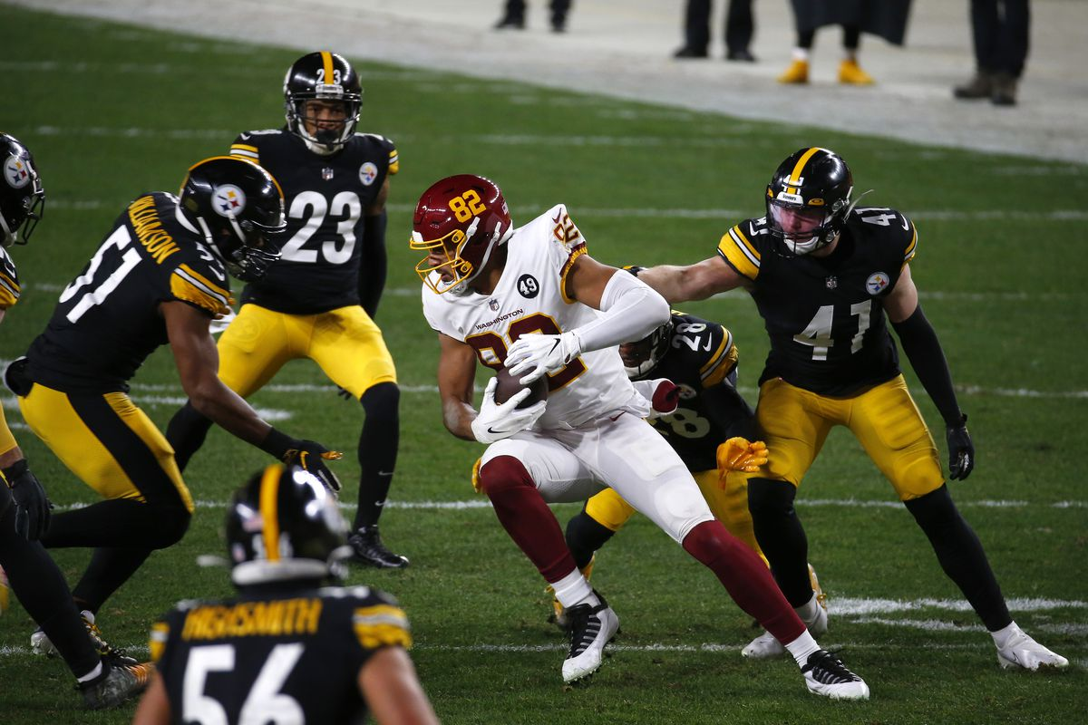 Logan Thomas #82 of the Washington Football Team looks to gain yardage during the second quarter of their game against the Pittsburgh Steelers at Heinz Field on December 07, 2020 in Pittsburgh, Pennsylvania.