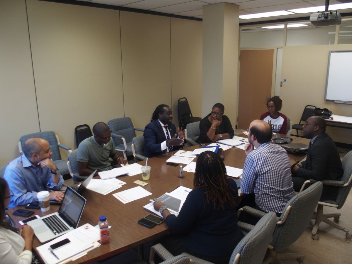 Members of the charter advisory finance subcommittee discuss potential fees charter schools would pay Shelby County Schools.
