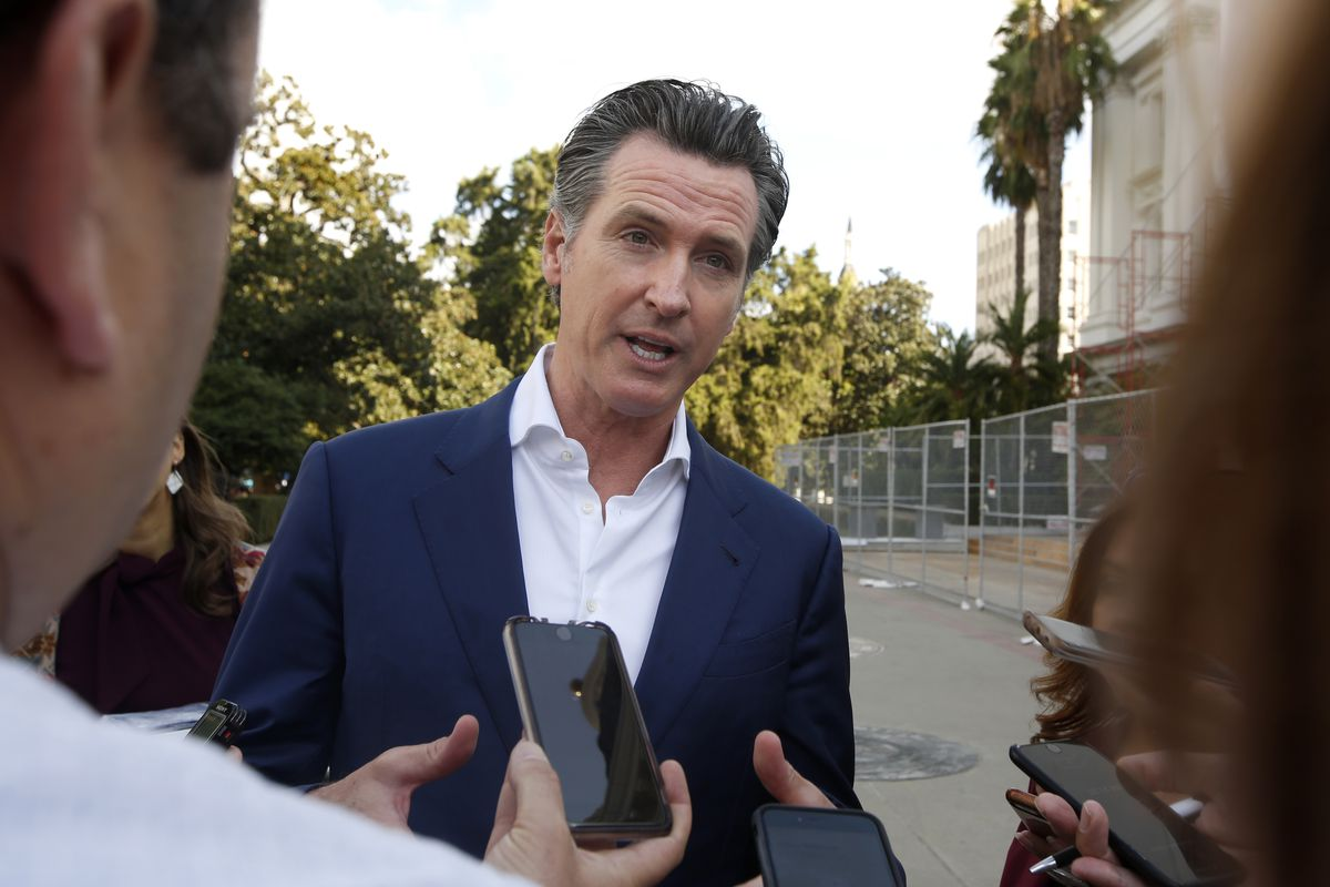 California Gov. Gavin Newsom talks with reporters at the 52nd Annual Native American Day in Sacramento, Calif., Friday, Sept. 27, 2019. (AP Photo/Rich Pedroncelli)