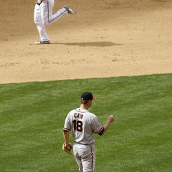 San Francisco Giants' Matt Cain (18) walks off the mound after gving up a home run to Arizona Diamondbacks' Lyle Overbay during the sixth inning in an MLB baseball game Sunday, April 8, 2012, in Phoenix.