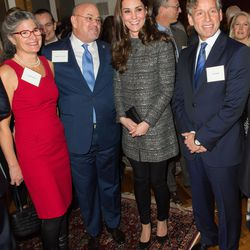 Dressed in a Tory Burch coat for a December 8th, 2014 reception in New York City.