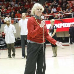 Jodi Majerus, a sister of the late Coach Rick Majerus, strolls upon the court that her brother once coached on during a halftime tribute at the University of Utah's Huntsman Center in Salt Lake City on Saturday, Feb.2, 2013. Coach Majerus, who passed away Dec. 1, coached the Utes from 1989-2004 — posting a 323-95 record and an appearance in the 1998 NCAA championship game.