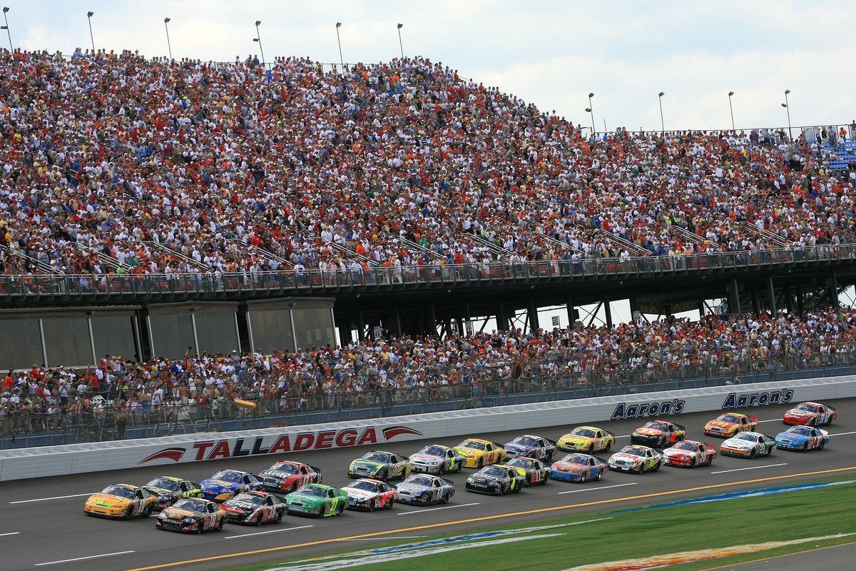 Brad Coleman, driver of the #18 Carino's Italian Grill Chevrolet, and Dave Blaney, driver of the #10 Haas Avocados Toyota, lead the field to the green flag to start the NASCAR Busch Series Aaron's 312 at Talladega Superspeedway on April 28, 2007 in Talladega, Alabama.