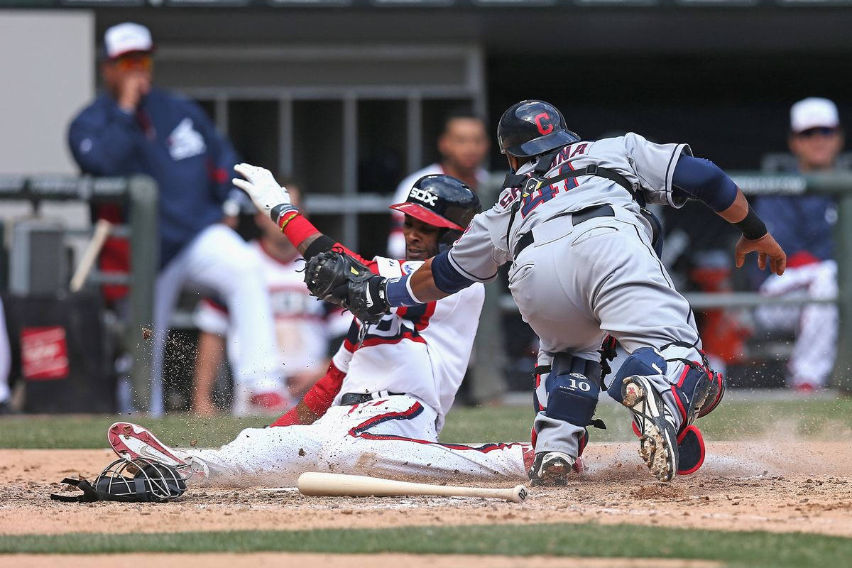 Alexei sneaks a back leg across the plate under Santana's tag, to tie the game at six