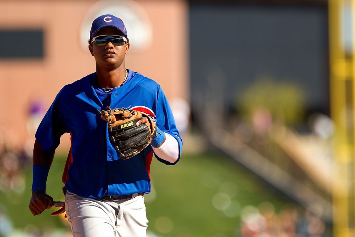 Salt River Pima-Maricopa, AZ, USA; Chicago Cubs infielder Starlin Castro makes his way back to the dugout against the Colorado Rockies at Salt River Fields at Talking Stick. Credit: Allan Henry-US PRESSWIRE