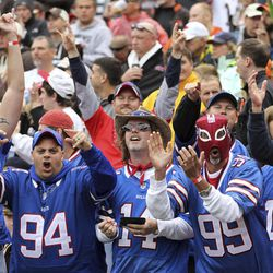 Buffalo Bills fans cheer after a Bills' touchdown in the fourth quarter of an NFL football game against the Cleveland Browns, Sunday, Sept. 23, 2012, in Cleveland.