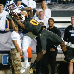 Brigham Young wide receiver Gunner Romney, back, battles for a pass with Arizona State defensive back Jack Jones (0) during an NCAA college football game at LaVell Edwards Stadium in Provo on Saturday, Sept. 18, 2021.