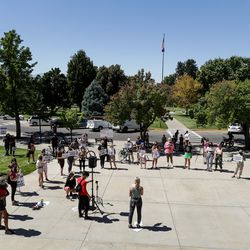 Protesters gather at Presidents Circle at the University of Utah in Salt Lake City on Thursday, Sept. 3, 2020. Responding to the university's handling of the case of slain student Lauren McCluskey, protesters called for the resignation of university president Ruth Watkins, the abolition of the university police department, and a redistribution of police funding into counseling and social services.