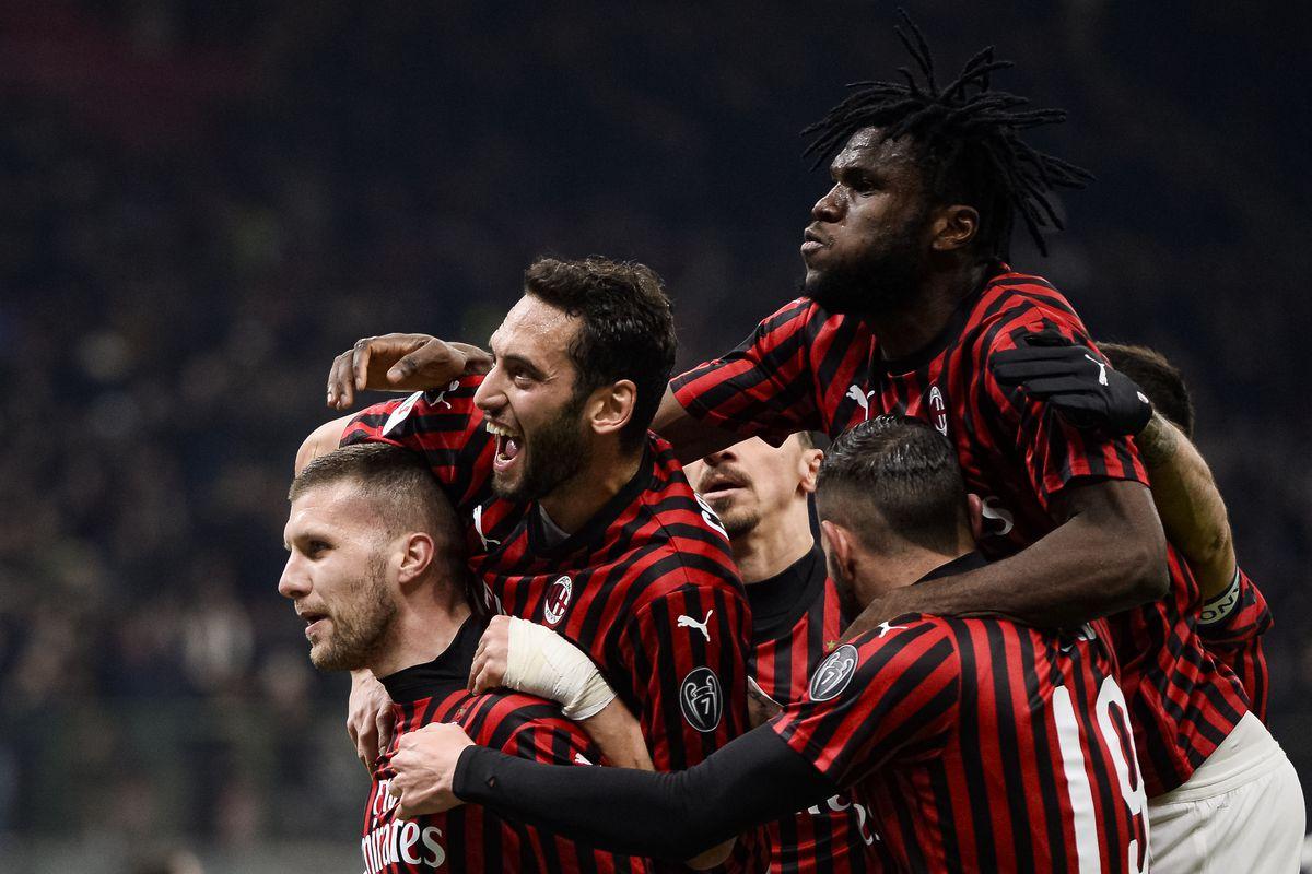 Ante Rebic (L) of AC Milan celebrates with his teammates...