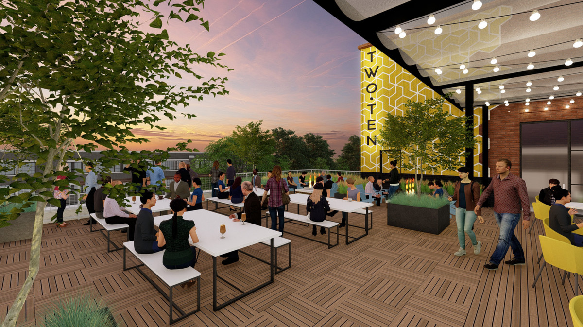 A nighttime rendering of the rooftop patio.