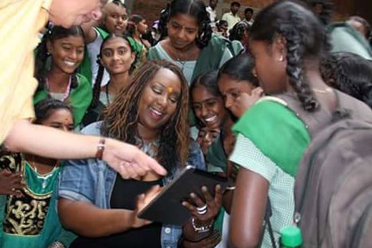 Melissa Collins visits with students during her two-week trip to India last summer.