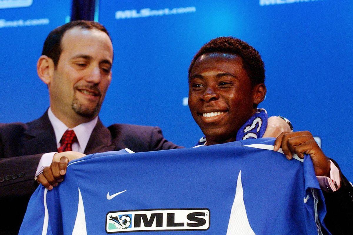 Freddy Adu (R), a 14-year-old soccer pro