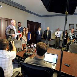 Former Utah Attorney General Mark Shurtleff speaks at the law offices of Snow, Christensen & Martineau in Salt Lake City Tuesday, July 15, 2014, after being arrested and posting bond.