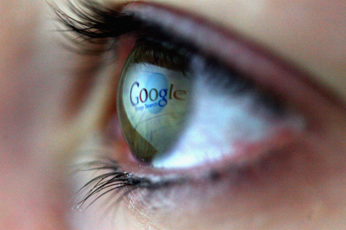 The google sign reflected in an eye
