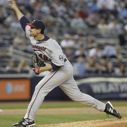 Minnesota Twins starting pitcher Carl Pavano throws during the first inning of a baseball game against the New York Yankees at Yankee Stadium in New York, Monday, April 16, 2012.