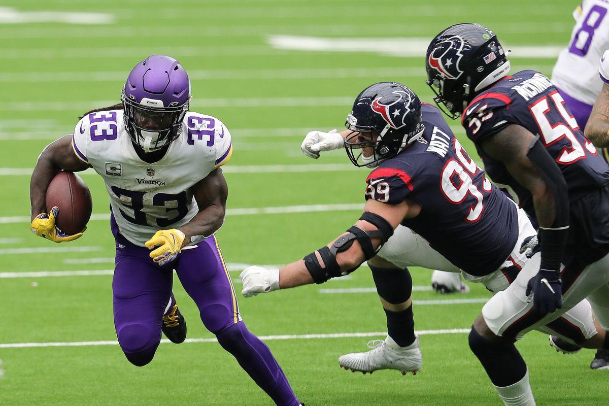 Dalvin Cook #33 of the Minnesota Vikings rushes past J.J. Watt #99 of the Houston Texans at NRG Stadium on October 04, 2020 in Houston, Texas.