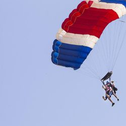 Wendell Ashcroft and  tandem instructor Scotty Freeland prepare to land with their patriotic parachute at Skydive Ogden in Ogden on Saturday, Aug. 5, 2017. Ashcroft is a veteran of the Korean War and served in the U.S. Air Force from Jan. 1, 1952, until  Dec. 31, 1956.