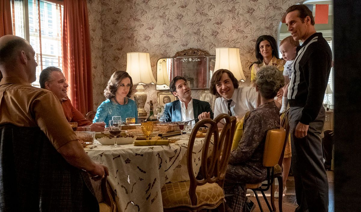 """A scene from """"The Many Saints of Newark"""" showing a large family around a dinner table."""