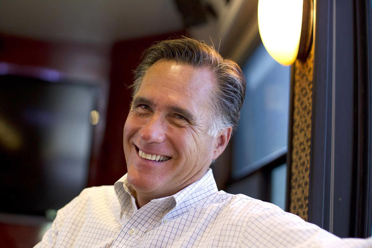 In this June 8, 2012, photo, Republican presidential candidate, former Massachusetts Gov. Mitt Romney smiles has he talks with his staff while riding on his bus after a campaign stop in Council Bluffs, Iowa. Republicans riding high from a string of breaks