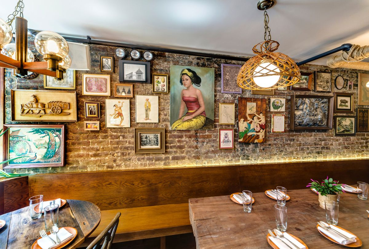 The interior of a restaurant with photos hanging on the wall
