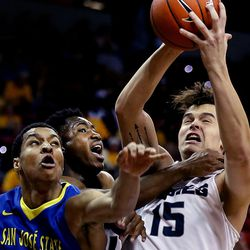 San Jose State Spartans' Brandon Clarke and Utah State Aggies' Koby McEwen and Norbert Janicek compete for the ball at the Mountain West Men's Basketball Championships at the Thomas & Mack Center, Las Vegas, Nevada on Wednesday, March 8, 2017.