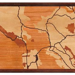 """<strong>Woodcut Maps</strong> San Francisco Bay Area Map, <a href=""""http://woodcutmaps.com/design/wood-inlay-wall-art/united-states/california/san-francisco/2051"""">$310</a> (choose one of many San Francisco maps or a map of your hometown)"""