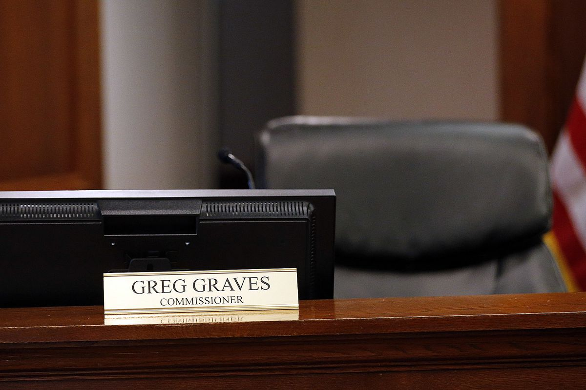 FILE - Utah County Commissioner Greg Graves' chair is empty as he participates by phone during commission meeting in Provo on Tuesday, Dec. 12, 2017.