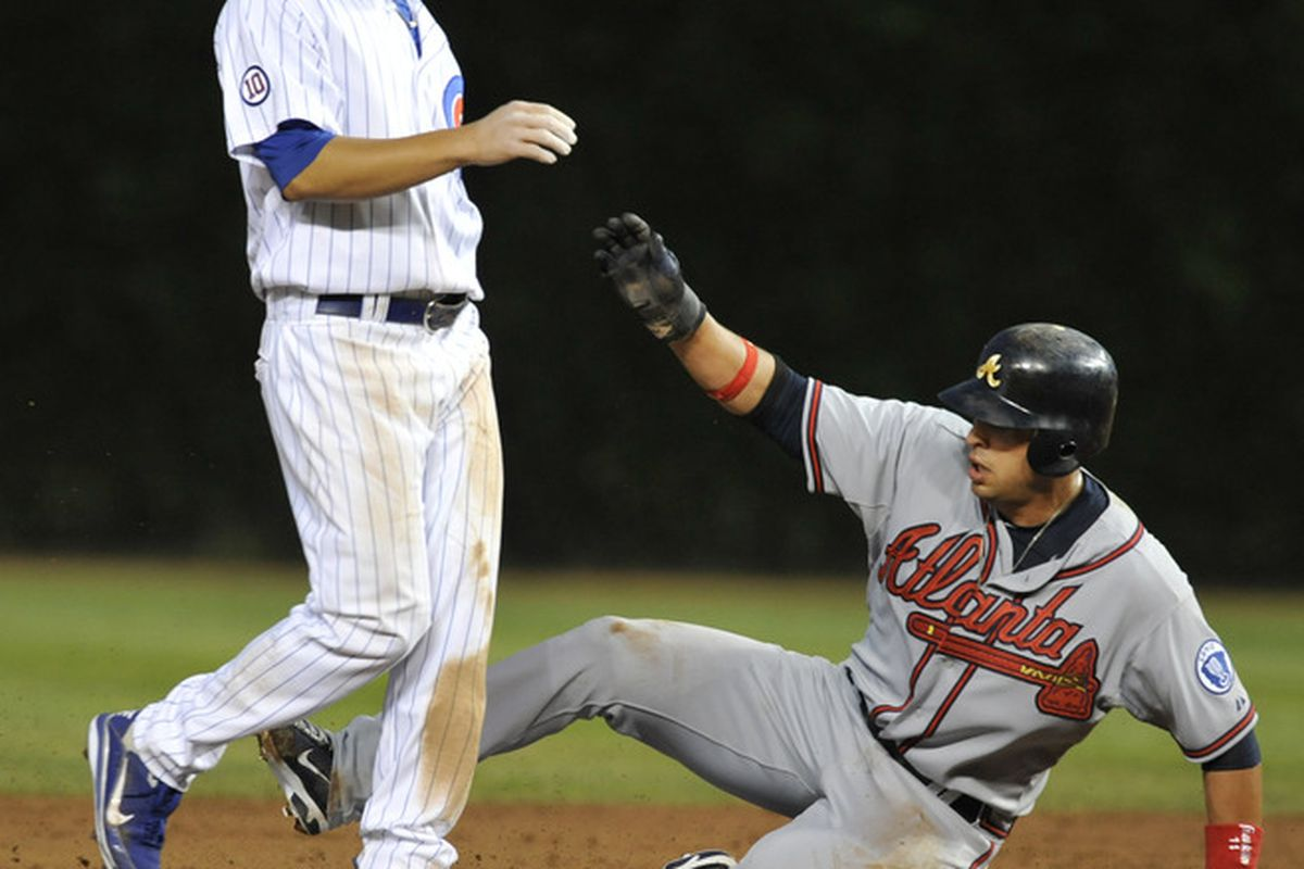 Hello, Martin! Martin Prado of the Atlanta Braves steals second base as Darwin Barney of the Chicago Cubs covers  the base at Wrigley Field in Chicago, Illinois.  (Photo by David Banks/Getty Images)