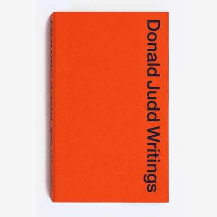 Orange book with black text.