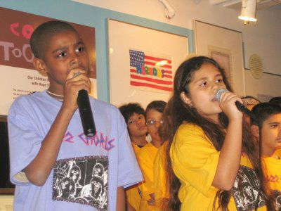 <em>The PS 22 Chorus performing last year at the Tribute WTC Museum. Courtesy of ##http://ps22chorus.blogspot.com##PS 22 Chorus##</em>