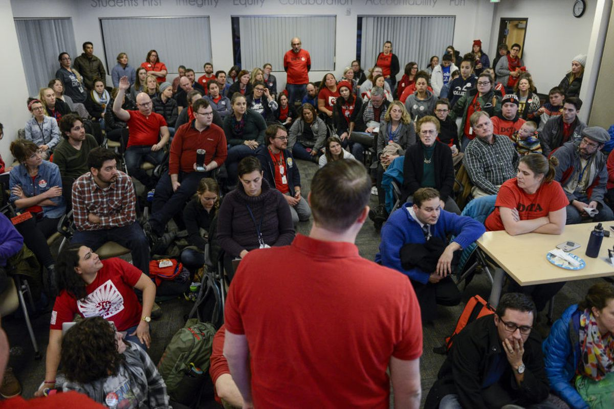 Denver Classroom Teachers Association deputy executive director Corey Kern speaks to a room full of teachers during a break in negotiations between the union and and Denver Public Schools in January.